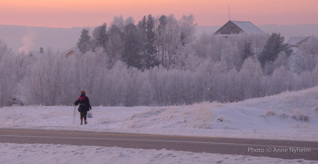 Woman walking her groceries home in minus 32 degrees cold, Røros, January 2016. Photo: copyright Anne Nyheim, mountain people.no